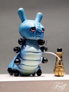Alice- in- Wonderland inspired custom Dunny caterpillar by artist Friff (courtesy of KidRobot's blog)
