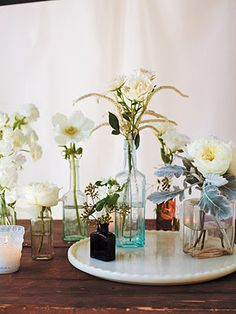 Small glass bottles from Matthew Robbins' Inspired Weddings, photo by Thuss + Farrell.
