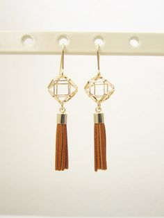 Geometric Dangling Tassle Earrings ($13.50) This dangling tassle earrings are perfect accessories for your casual or formal outfits. The dangling tassle adds some bohemian and playful vibe to your look. Made in Korea.