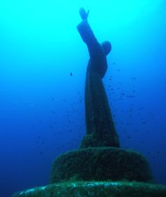 Il Cristo degli Abissi, San Fruttuoso Bay, Portofino, Italy: cast in bronze by Guido Galletti and sunk in 1954, the nearly nine-foot-tall Christ of the Abyss gets around. There are copies stretching their arms peacefully toward the heavens both underwater in Key Largo and on land in Grenada. Following a 2004 restoration that replaced a severed hand, the original rests again in 50 feet of water just offshore from San Fruttuoso's 11th-century abbey.
