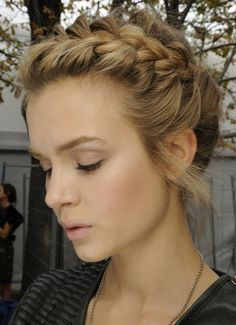 I think that something like this is what I'm leaning towards.  I like the sideswept front braid.  Though I imagine we'd have to put a fair bit of spray or something into my hair to get it have a bit more volume and be a bit more crunchy and less silky.