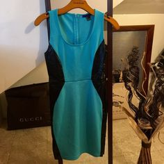 Turquoise and leather dress Perfect combo! Turquoise color with leather on sides that accentuate figure! Stretchy material worin only once! Forever 21 Dresses