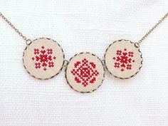 Cross stitch necklace with three royal red ornament in by skrynka, $28.00
