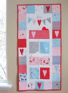 I'm starting to pull out the Valentine's Day decor. I tend to leave a lot of my red and white decorations up after Christmas, including my snowflake pillows because they add some color right Valentine's Day. This year I have a fun new wall hanging to add to my Valentine's decor – my Love Notes quilt created for the Moda Sweet Celebrationsbook. Sweet Celebrationsis full of projects for ideas throughout the year. I have a handful of copies of Sweet Celebrations left in my shop. They are on…
