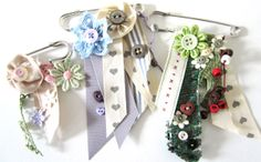 I want to use kilt pins!!! Great idea source too.... Be nice for a spring/summer brooch.... Makes me think of 'Best in Show'