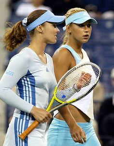 Martina Hingis of Switzerland and Anna Kournikova of Russia talk strategy during their doubles match against Laura Granville and Jennifer Hopkins of...