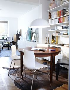 work area divides open living space  #housebeautiful #dreamlivingroom