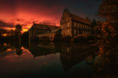 Castle Herten at night by Robert Karo