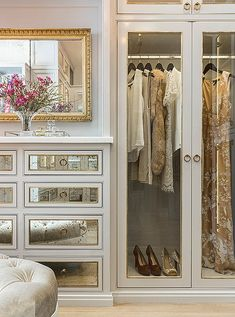 A mix of clear glass and antiqued mirror gives the master closet a glamorous feel (while keeping clutter hidden away).