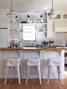 white washed farmhouse kitchen with beautiful barn lighting click to get the look barn lighting create rustic