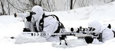 A South Korean Army sniper (with sniper rifle) and his spotter, Janurary during cold weather training for ROK Army Special Forces.