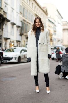 Click here to see the best white faux fur fuzzy mid length coats for under $200: http://www.slant.co/topics/4405/~white-faux-fur-fuzzy-mid-length-coats-for-under-200