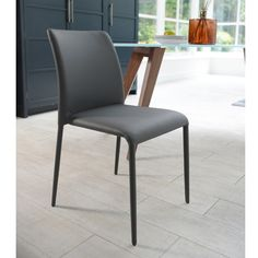 Completely covered in soft tactile faux leather this seat offers sophistication while also delivering on comfort. The lightly padded seat sits above elegant slim legs, again showing in design sometimes less is more. Comes in four contemporary colours Kitchen Table Chairs, Modern Dining Chairs, Dining Room Chairs, Table And Chairs, Grey Chair, Dining Room Design, Extension Ideas, Contemporary, Slim Legs