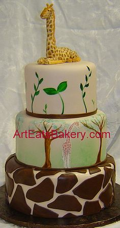 http://cakedecoratingcoursesonline.com/cake-decorating/ Three tier jungle theme baby shower custom cake with hand painted trees, leaves and fondant giraffe topper. Looking for Best #Baby Shower #Cake? - Learn Amazing #Cakes #Design Creating on http://CakeDecoratingCoursesOnline.com and Make Your Dream Baby Shower Cake Yourself