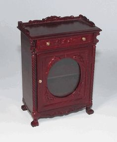 "Miniature mahogany cabinet by Bespaq. 2 & 1/2"" x 1 & 1/2"" x 3 & 1/4"" high. --- $39.99"
