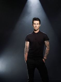 Adam Levine in black polo and pants