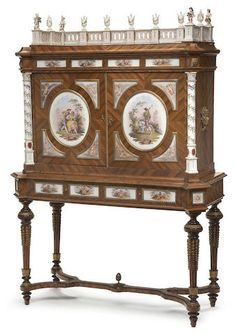 A Louis XVI style gilt bronze and porcelain mounted walnut cabinet on standfourth quarter 19th century
