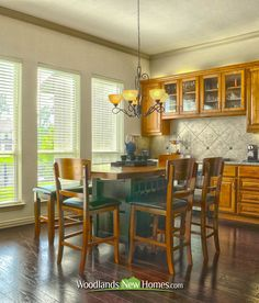 Gorgeous breakfast room with #hardwood floors, #cabinets and sink.