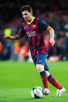 Lionel Messi of FC Barcelona runs with the ball during the La Liga match between FC Barcelona and RC Celta de Vigo at Camp Nou on March 26, 2014 in Barcelona, Catalonia.
