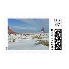 USA, Utah, Monument Valley. Sagebrush shows Postage