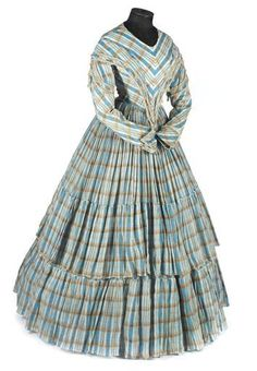 one piece gown, the fabric sky blue and tan check, the dropped shoulders and deep pointed bodice embellished with cream silk fringe, the full skirts tiered 1850s Fashion, Victorian Fashion, Vintage Fashion, Victorian Dresses, Vintage Vogue, Victorian Era, 1800s Clothing, Historical Clothing, Vintage Clothing
