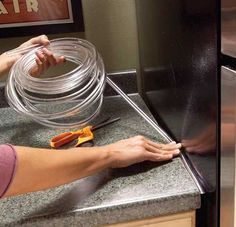 Countertop Gap Filler. If crumbs, papers or even flatware falls into the gap between your countertop and refrigerator, fill the void with nearly invisible plastic tubing. Clear tubing is available at home centers in several widths starting at 1/8 in.