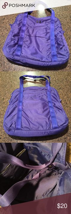Under Armour Gym Bag Large bag that is great for the gym or school. Does not include the detachable strap, but one can be added. Will fit a laptop. Color is more blue than purple. Under Armour Bags