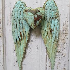 Angel wings wall decor with heart shabby chic rusty metal cottage mint blue sea foam mix  Anita Spero
