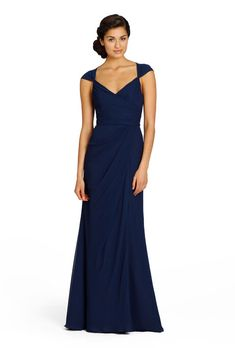 Brides: Jim Hjelm Occasions. Navy blue is one of the most sophisticated and timeless colors in the ROYGBIV spectrum. Close enough to black, navy maintains the same allure of the dark neutral, but also flaunts the cool and match-worthy appeal of blue. It should therefore come as no surprise, then, that navy blue has never gone out of style, which makes it an ideal choice for your bridal party attire no matter the season, setting or personal taste of your, ahem, most opinionated bridesmaid.