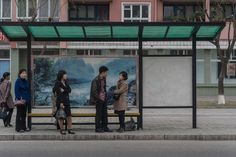 Picture of people waiting at a bus stop in North Korea Life In North Korea, South Korea, Korean War, Bus Stop, Pictures Of People, Zine, Seoul, History, Shelter