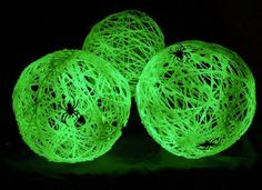 DIY SPIDER BALL WEBS!!!  Blow up desired number of #balloons. Wind yarn around the balloons and spray with starch. Allow to dry. Spray with glow-in-the-dark spray paint. Allow to dry. Pop balloons and remove any remaining balloon scraps from inside. Attach spiders of various sizes (may have to either glue or tie on). Suspend with thin film wire.