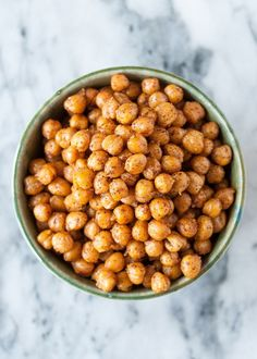 This has to be one of the EASIEST chickpea recipes around. Roasted in the oven, chickpeas transform into a crispy, salty, savory snack. So tiny. So easy to eat by the handful. Here is our step-by-step recipe for roasting chickpeas in the oven.