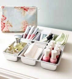 Getting Organized: 25 Totally Clever Storage Tips and Tricks for Summer- Keep those tips and tricks coming. Mini loaf pans are not just for baking anymore when you can use them to store your makeup and nail polishes. Losing batteries all the time? Pick up a tackle box next time youre out and you will find they will all fit neatly inside. #nailcolour
