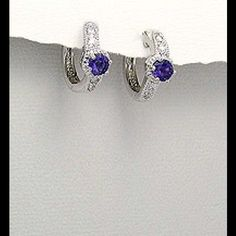 Amethyst and  CZ earrings Rhodium plated brass earrings decorated with amethyst and cz. Jewelry Earrings