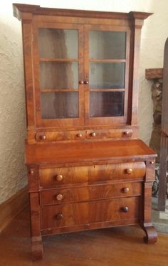 The Secretary desk is from the 1850's -1860's and has a beautiful Mahogany veneer. The bookcase portion has three shelves and multiple storage compartments. The desk portion has three smaller drawers and one large drawer. There is a drop down desk multiple storage compartments and ink well. The desk be a nice addition to any home or office. The price is $1,950. If you are interested feel free to give me a call at (937) 271-7170 or send me an email