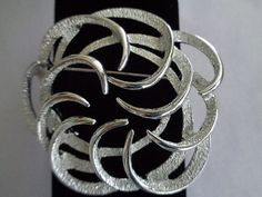 """Sarah Coventry Round Silvertone Brooch 3"""". This signed brooch can be viewed at www.CCCsVintageJewelry.com and you can read about the designer and others on our blog which you can easily found by adding the word blog to our website. We are also offering free shipping to orders that are over $50.00 to the United States. Happy Holidays to you and yours, CCC."""