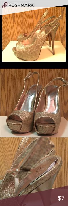 Deb Gold sparkly slingback heels Deb gold sparkly slingback heels size 7           The foot pad at the heels are separating a little. Good used condition besides that. Haven't worn in awhile. Deb Shoes Heels