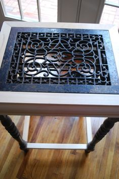 Repurposed antique iron grate parlor table.  www.tomorrowsantiques.com
