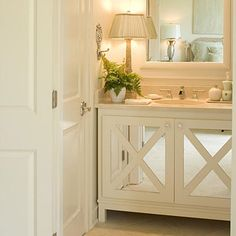 Guest bath: A cabinet vanity could overwhelm this tiny room, but matching the cabinet color to the wall color and mirrored cabinet doors help the room feel more open. Bad Inspiration, Bathroom Inspiration, Guest Bathrooms, Cabinet Colors, Beautiful Bathrooms, Interiores Design, Home Remodeling, Small Spaces, House Design
