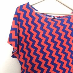 NWOT Off-the-Shoulder Chevron Top NEW WITHOUT TAGS // Worn Once. Off-the-Shoulder Royal Blue and Orange Chevron Top. Slight wing on one side. Excess material at waist for bunching and rouching.  Made of Polyester and Spandex. Extremely stretchy and silky feeling material //Cefian USA brand purchased from a boutique. There aren't many of these out there! // sz L // non smoking home Cefian Tops Blouses
