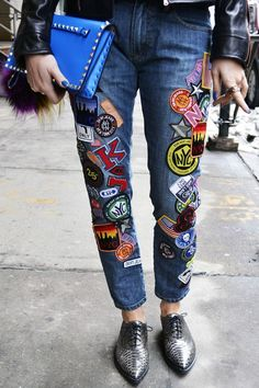 All patched up denim trouseers with black leather jacket. Rocker fashion trend. Streetstyle inspiration.