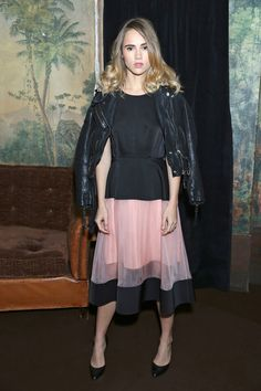 Suki Waterhouse toughens up a sweet tulle skirt with a luxe leather jacket.