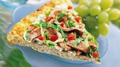 Dinner ready in 25 minutes! Roast beef, tomatoes and lettuce mixed with Italian salad dressing makes this delicious sandwich pizza.
