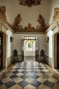Photos: Portugal's Beautiful Alentejo Region Has It All - via Condé Nast Traveler 07.03.2015 | Written by Guy Trebay, Photographed by Matthieu Salvaing | Photo: A foyer at Pousada dos Lóios, a monastery turned boutique hotel in Évora.