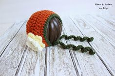 Crochet Pumpkin Bonnet with Flower by FiberAndTwine. Perfect for fall pictures or just for keeping your little one warm!