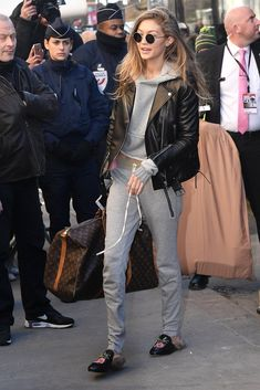 9c297991c57d While Arriving at the 2017 Victoria's Secret Fashion Show, Gigi Wore Her  Loafers With a Gray Tracksuit