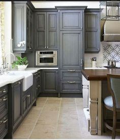 Instead of various heights in upper cabinets.  Try various depths, with crown molding to stand out.