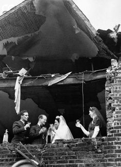 The wedding of officer J.C. Martin and Edna Squire Brown, in a bombed out building, November 5, 1940.