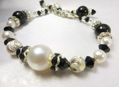 Black and White Bracelet with Swarovski Pearls, Diamond Cut Sterling Silver Beads