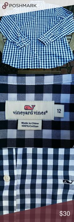"Vineyard Vines navy/white check button down sz 12 Very gently worn women's navy blue and white check button down from Vineyard Vines! In excellent condition! No holes, stains, tears, or defects! Great staple for any wardrobe!   Size 12. 100% cotton. Bust = 20.5"", Length = 28"" All sales final. Tops Button Down Shirts"